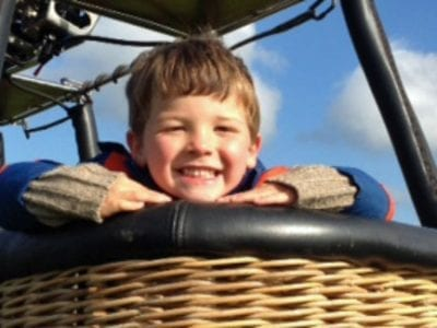Smiling Child In Hot Air Balloon